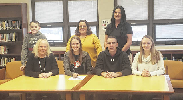 Northmor athlete Macy Miracle (front row, second from left) signed her letter of intent to play volleyball for the University of Rio Grande. In the front row with her are (l-r) parents Lisa and Todd and sister Hope. In the back row are brother Cade, Northmor volleyball coach Kara Wright and Rio Grande volleyball coach Billina Donaldson.