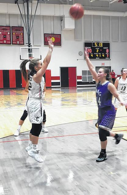 Cardington's Mikayla Linkous puts up a shot in her team's Saturday night win over Mount Gilead.
