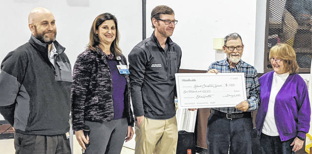 OhioHealth Mansfield Trauma team present Ron and Sue Criswell a check for $1,000 for Gilead Christian School. Shown from left: Chris Ambrosino, CNP Clinical APP Manager, Heidi Jenkins, RN Trauma Program Manager and Jason Straus, MD Trauma Medical Director, OhioHealth Mansfield.
