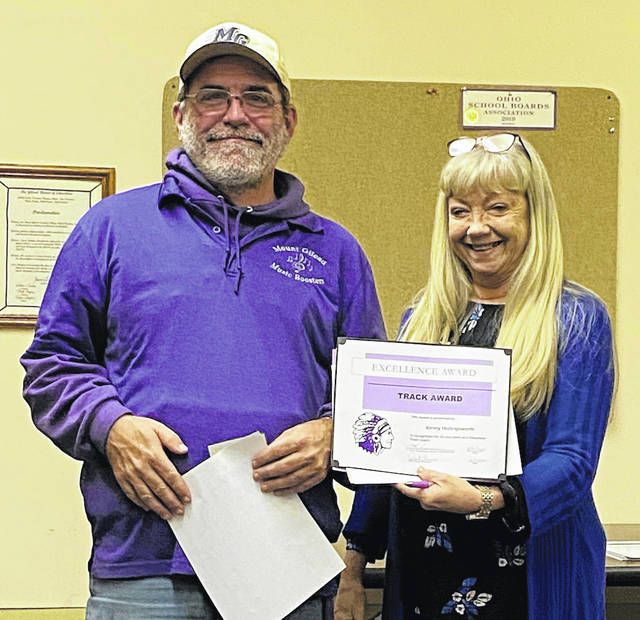"The Mount Gilead Board of Education and Mount Gilead Exempted Village Schools honored Kenny Hollingsworth for his dedication to the district for about 30 years. Kenny has served the school in a variety of ways including: volunteer track coach, cross country volunteer, Mount Gilead Athletic and Music Boosters member. High School Principal Deb Clauss, shown presenting the certificate, and the Board of Education agreed that he is the district's go to person stating, ""When something needs done, call Kenny."""