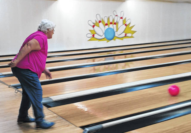 Throwing the first ball to open the 13th annual Strike for the Cure is Karen Whirl, a breast cancer survivor Also rolling a ball down a ramp was Jessica Stried-Vicars in honor of her mother, Debbie Popp, co-owner of Morrow Lanes, who is fighting breast cancer.