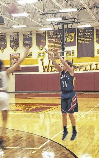 Highland's Brooklyn Baird goes up for three of her eight points in Tuesday night's district semifinal at Westerville North.