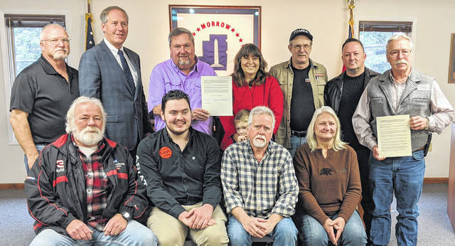 Shown in back, from left: Paul Haubert, Commissioners Tom Whiston and Burgess Castle, Liz Combes, Denny Tubbs, Art Woddell and Commissioner Warren Davis. Front row: Dale Baker, Jacob Novotny, Joel Dorfe and Mary Neumann.