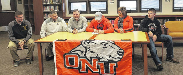 Northmor senior Brandon Planey signs his letter of intent to play football for Ohio Northern University. Pictured above are Northmor athletic director Justin Hershberger, Northmor head football coach Scott Armrose, father Matt, Planey, mother Shelley and brother Ben.
