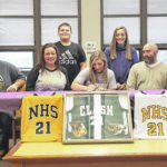 Linkous signs with Defiance for basketball