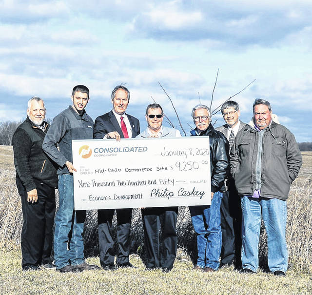 Consolidated Cooperative awards $9,250 in funding for Phase 1Environmental Site Assessment of the Mid-Ohio Commerce site. Pictured from left: Dan Boysel, Consolidated Cooperative; Ryan Lanker, property owner; County Commissioner Tom Whiston; Brad Ebersole, Consolidated Cooperative; County Commissioner Warren Davis; Morrow County Economic Development Director Andy Ware and County Commissioner Burgess Castle.