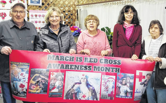 Board members shown, from left: Dwight McFarland, Brenda Harden, Rita Barton, Janet Rhodebeck and Nancy Foos of the Morrow County Chapter of the American Red Cross display a banner at Keith's Flower Shop in downtown Mount Gilead.