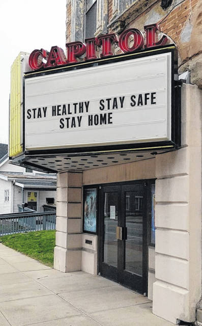 Sign on the marquee at the Capitol Theatre in downtown Mount Gilead. The national stay-at-home order is extended through April 30 due to the coronavirus.