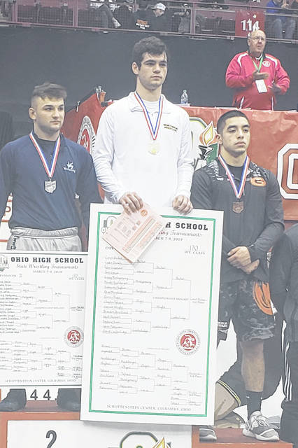 Northmor senior Conor Becker, pictured at the top of the podium after winning a state title in wrestling last year, won't be able to defend his championship this spring after the decision was made by the OHSAA to cancel the previously-postponed winter sports tournaments. Becker was one of seven Morrow County wrestlers to see his season end prematurely as a result of that decision.