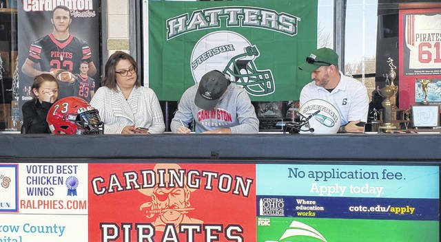Cardington senior Brydon Ratliff signs his letter of intent to play football for Stetson University. With him in the above picture are (l-r) sister Gabby, mother Amanda and father Andy. Not pictured is sister Kinnedy.