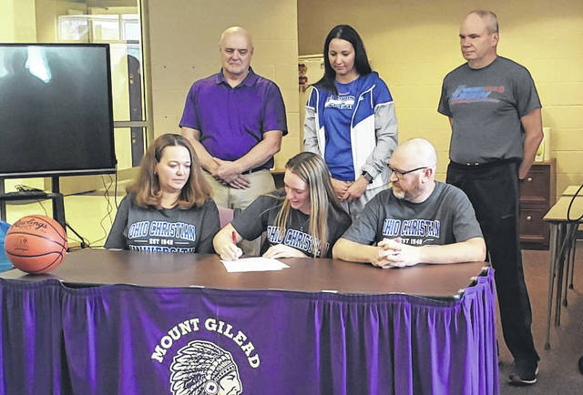 Mount Gilead senior Dakota Shipman signed her letter of intent to play basketball for Ohio Christian University. Pictured above are, top row (l-r): MG head basketball coach Bob Scott, OCU head basketball coach Brenda Baker and MG assistant basketball coach Gary Miller. Front row, mother Melissa, Shipman and father Jeremy.