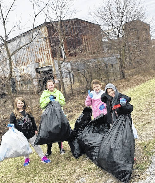 Students took to the streets to clean up part of Mount Gilead this week. Aryn Morrow, Alexis Gibson, Rileigh Roscoe and Elliot Roscoe picked up litter on Delaware Street. They collected four bags of trash and two bags of recycled materials.
