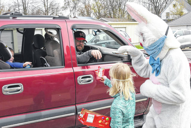 Even the Easter Bunny wore a mask Sunday in Cardington where more than 100 kids and parents drove by at the Legion Park.