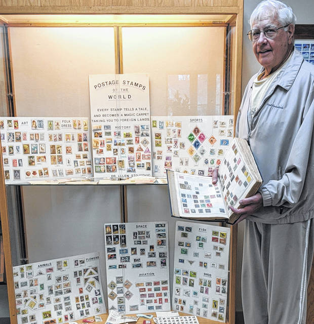 Allen Stojkovic with his stamp collection at the Mount Gilead Library. Besides history, some categories of the collection are sports, fish, arts, 1996 Atlanta Olympics, birds, flowers, space and aviation.