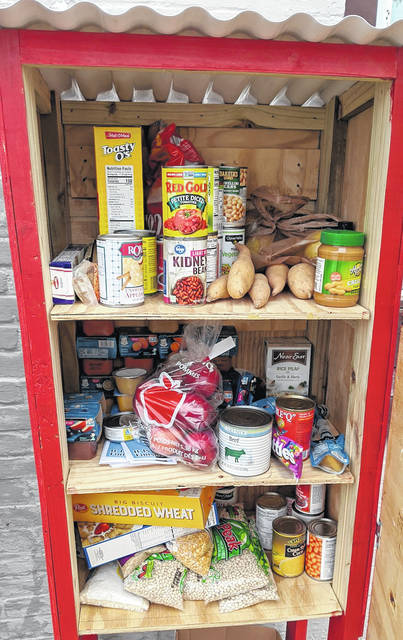 "Contents in the Edison Blessing Box were first stocked by the Skipworths and are being monitored and filled by the community and the group ""Helping Others in Morrow County."""
