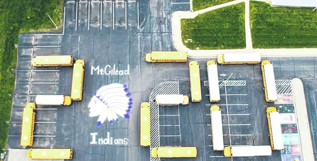 Mount Gilead Schools Transportation Department created this by arranging buses in the parking lot. They drew, painted, and designed the 2020 Indian completely from scratch, according to high school principal Deb Clauss.