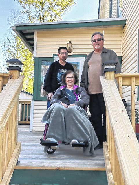 Courtesy Photo | Jodi Moss Linda Ullom with her husband, Tom, and son, Tim, at their Cardington home following the passing of the caravan welcoming her home.