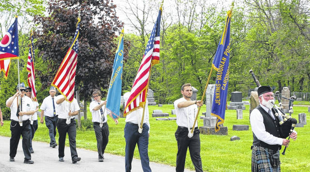 Courtesy Photo   Valerie Mories Jenkins-Vaughan Post 97 and squadron 97 leading the Cardington Memorial Day parade in the cemetery.
