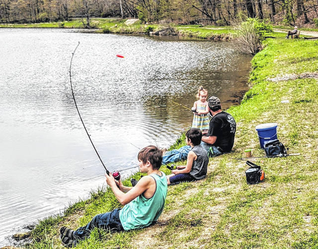 Sentinel Photo Conner casts his line at the Mount Gilead State Park with Trenton, his dad Sunney Murphy and sister Marissa. The Murphy family enjoyed the sunshine Sunday afternoon with others who were fishing, hiking and boating.