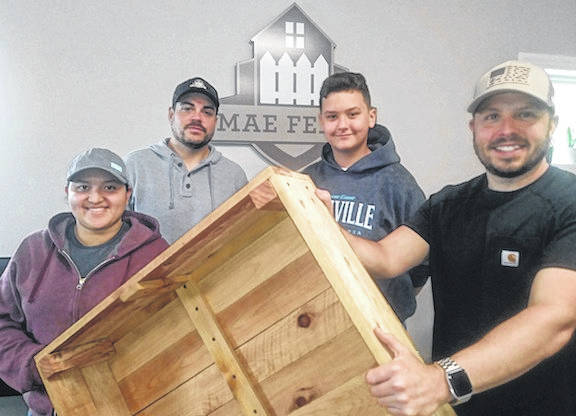 Cyrus Landis-Feuston, of Cardington, donates handmade cedar boxes to the Woodside Village Care Center in Mount Gilead. Shown, from left, are Melina Ortega, production manager; Adam Van Gorp, general manager; and Tim Surprise, owner.