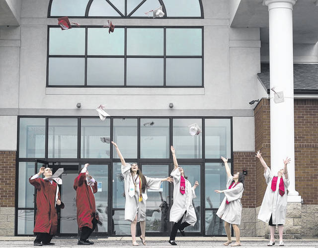 Gilead Christian School's six graduates toss their caps in the air after graduation. Next week we salute all Morrow County schools graduates with our souvenir edition. Top 10 students, graduation and scrapbook photos will be in the insert on June 24.