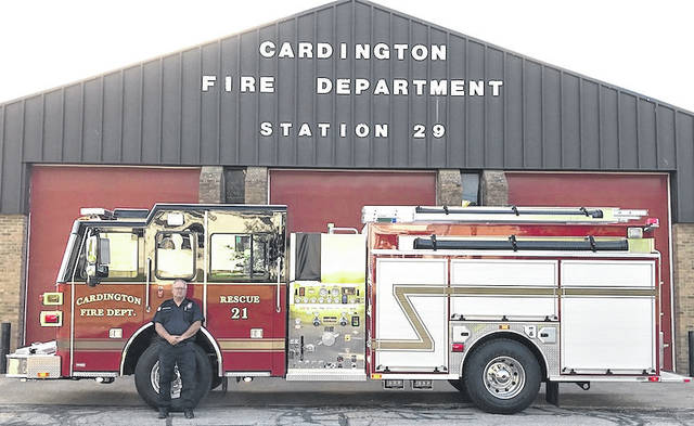 Cardington Fire Chief Gary Goodman stands with the department's new 35-foot fire engine.