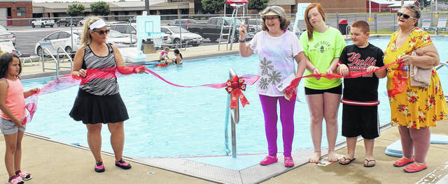 Courtesy Photo Cutting the ribbon to the new pool stairs at the Cardington Pool are, from left: Aliyah Graham, Tracy Zeigler, Angela Boyd Dendinger, Brooklyn and Cayden Smith and Carrie Zyonoski.