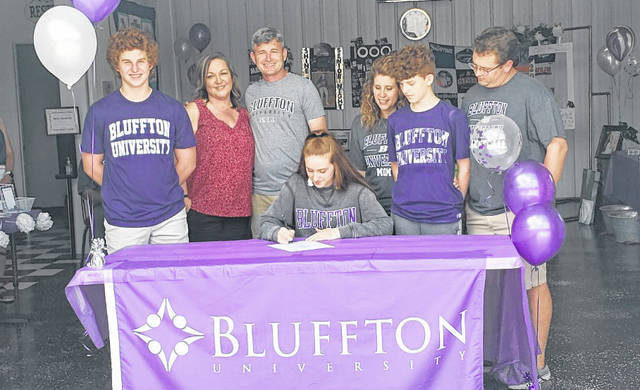Mount Gilead graduate Madison Fitzpatrick signs to play basketball for Bluffton University while with her family. In the picture are (l-r): Turner Fitzpatrick, Christina Ferrington, Bob Fitzpatrick, Madison Fizpatrick, Beth Tracy, Rowan Fitzpatrick and Travis Tracy.