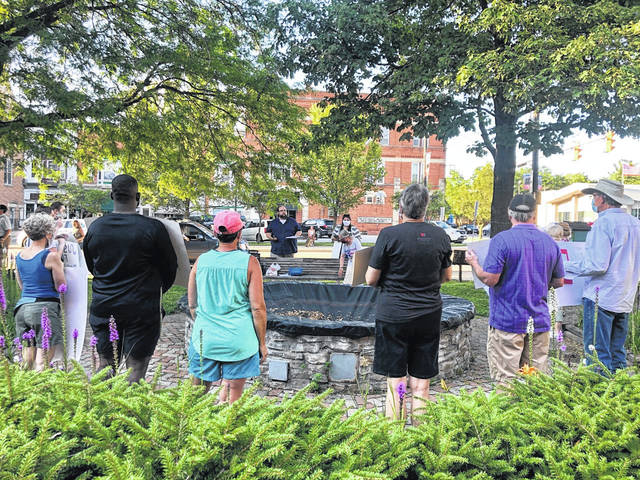 Local residents for solidarity and healing sponsored walk and vigil took place in Mount Gilead Saturday evening. The group met at the Presbyterian Church, then walked uptown and up and down Main Street and returned to the square for the vigil.
