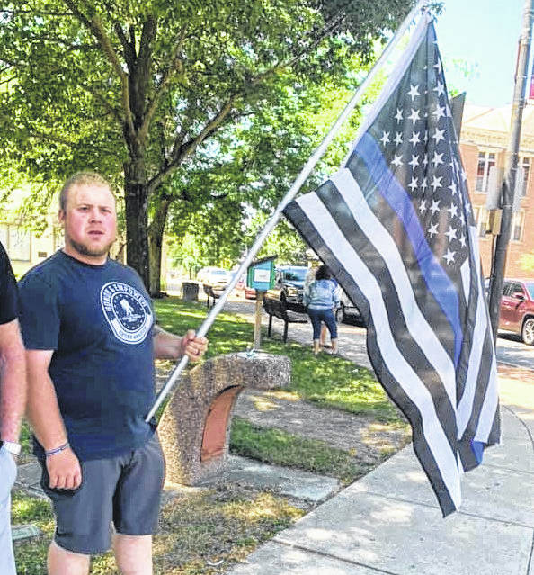 Area residents displayed Back The Blue flags and signs to show support for local law enforcement at a rally Saturday.