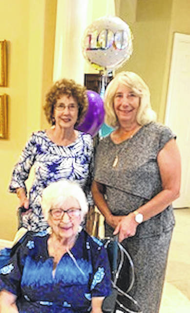 Courtesy Photo Mary McAlister, seated, at the reception honoring her on her 100th birthday. July 12. Standing are her daughters, Julie Pecko and Linda McAlister.