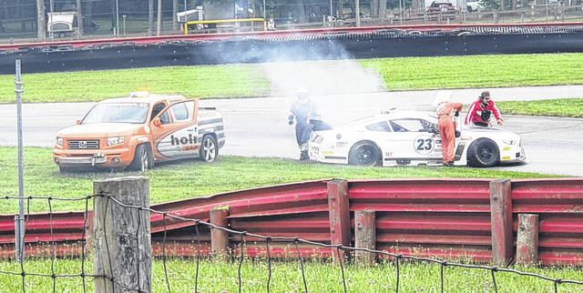 Mid-Ohio safety personnel were quick to come to the aid of a Vintage Grand Prix driver suffering car issues.