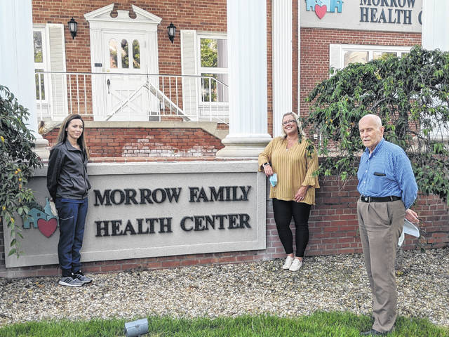 Sentinel Photo Morrow Family Health Center Site Manager Kara Maynard, Patient Support Manager Meghan Taylor and Chief Medical Officer Dr. Henry Heinzmann.