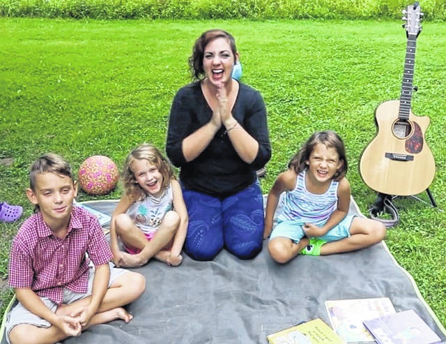 "Selover Library's online story time stars, ""Miss Brielle"" Kincaid and her children Zeke, Ana, and Belle."