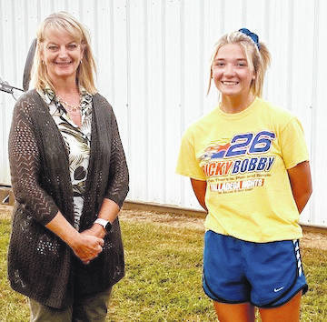 Pictured is Ashley Huffine, winner of the Junior Fair Leadership Award, made by the Morrow County Republicans. She is pictured with Kim Bood, Morrow County Clerk of Courts who presented the award.