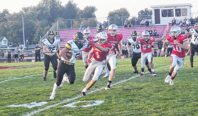 Northmor's Niko Christo fights for yardage in his team's win over Fredericktown Friday night.