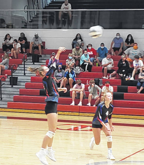 Makenna Belcher hits the ball for Highland in their three-set win over Cardington Thursday night.