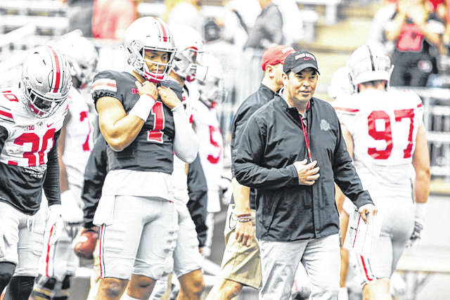 Lima News photo Ohio State quarterback Justin Fields and coach Ryan Day are ready for another — albeit, much different — football season. The Buckeyes open up Oct. 24, at home, vs. Nebrasha