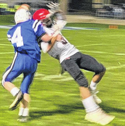 Cardington receiver Garrett Thompson is knocked down by a Danville defender in the first half.