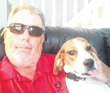 Kevin Farrell and Duncan, who has become the disabled veteran's service dog and companion.