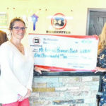Bonecutter donation assists Kiwanis with books for kids