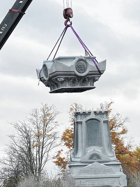 Crews worked Wednesday, Oct. 21 using a crane to remove the Soldiers Monument from Glendale Cemetery. More photos at morrowcountysentinel.com.