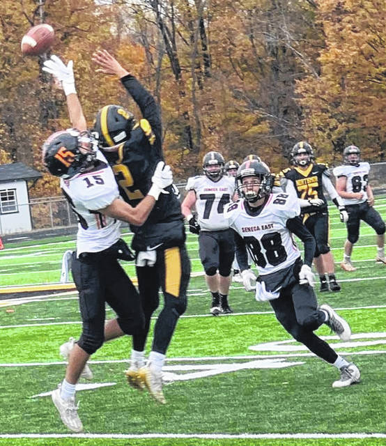 A pass is just beyond the reach of Trenton Ramos in the second half of Northmor's 27-6 loss to Seneca East Saturday afternoon. Caleb Heiser defends for the Tigers.