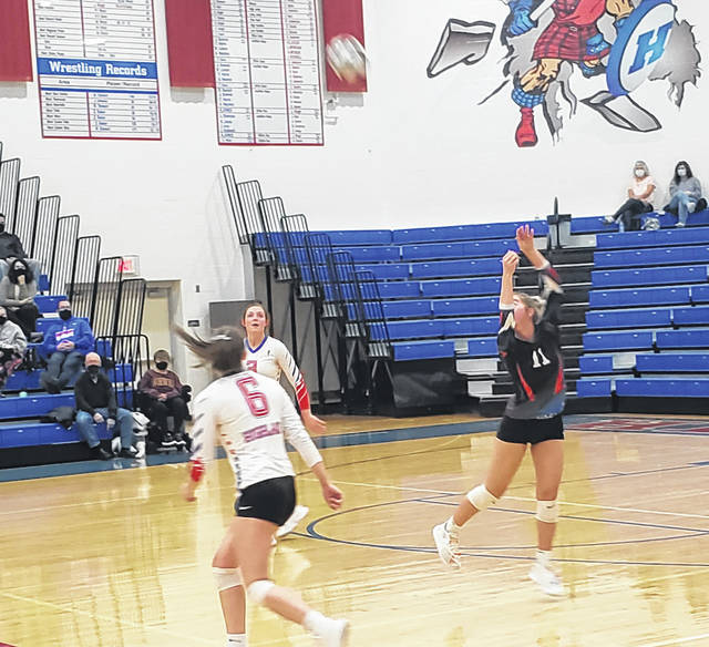 Highland's Brylinn Tuggle returns a Lakewood hit in her team's three-set district semifinal win over Lakewood Thursday night.