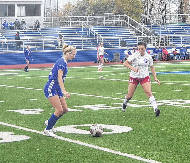 Caley Evans controls the ball for Highland Saturday in their tournament contest against Licking Valley.