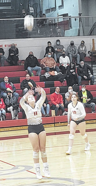 Kyleigh Bonnette sets the ball in Cardington's five-set win over Worthington Christian Wednesday night while teammate Kayleigh Ufferman watches.