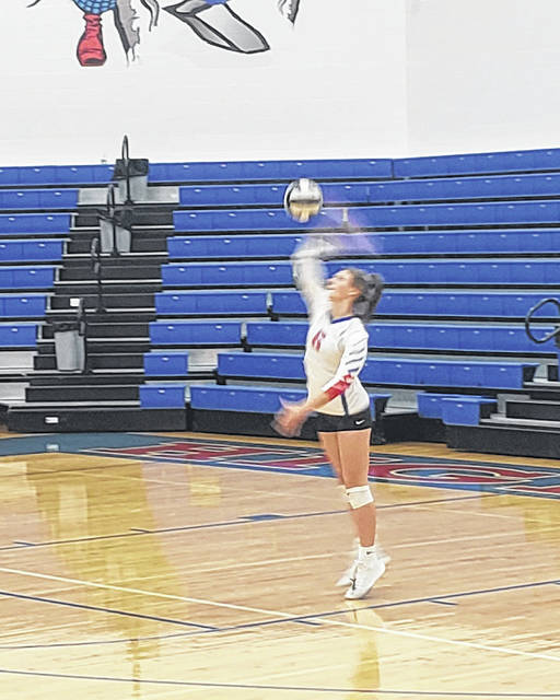 Highland's Makenna Belcher serves for Highland in their three-set sweep of Mount Gilead on Tuesday.