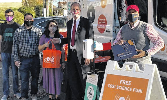 COSI staff distributed 100 Nature kits to Mount Gilead Students Monday. From left: Dylan Jones, Mayor Jamie Brucker, Charlotte Fletcher, Morrow County Commissioner Tom Whiston and Steve White from Center of Science and Industry (COSI) in Columbus.