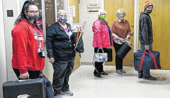Mount Gilead Vo Ag students Jillian West Johnston and Preston Clark carry in bags from the Peru Township and Cardington polls to the Board of Election on Tuesday evening. All precincts had reported in by 9:30 p.m.