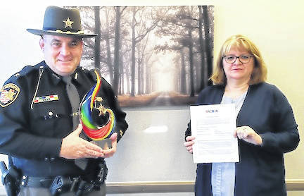 Morrow County Sheriff John Hinton is presented with the 2020 CARES Award. He is shown with Deanna Brant, executive director of the Delaware-Morrow Mental Health and Recovery Services Board.